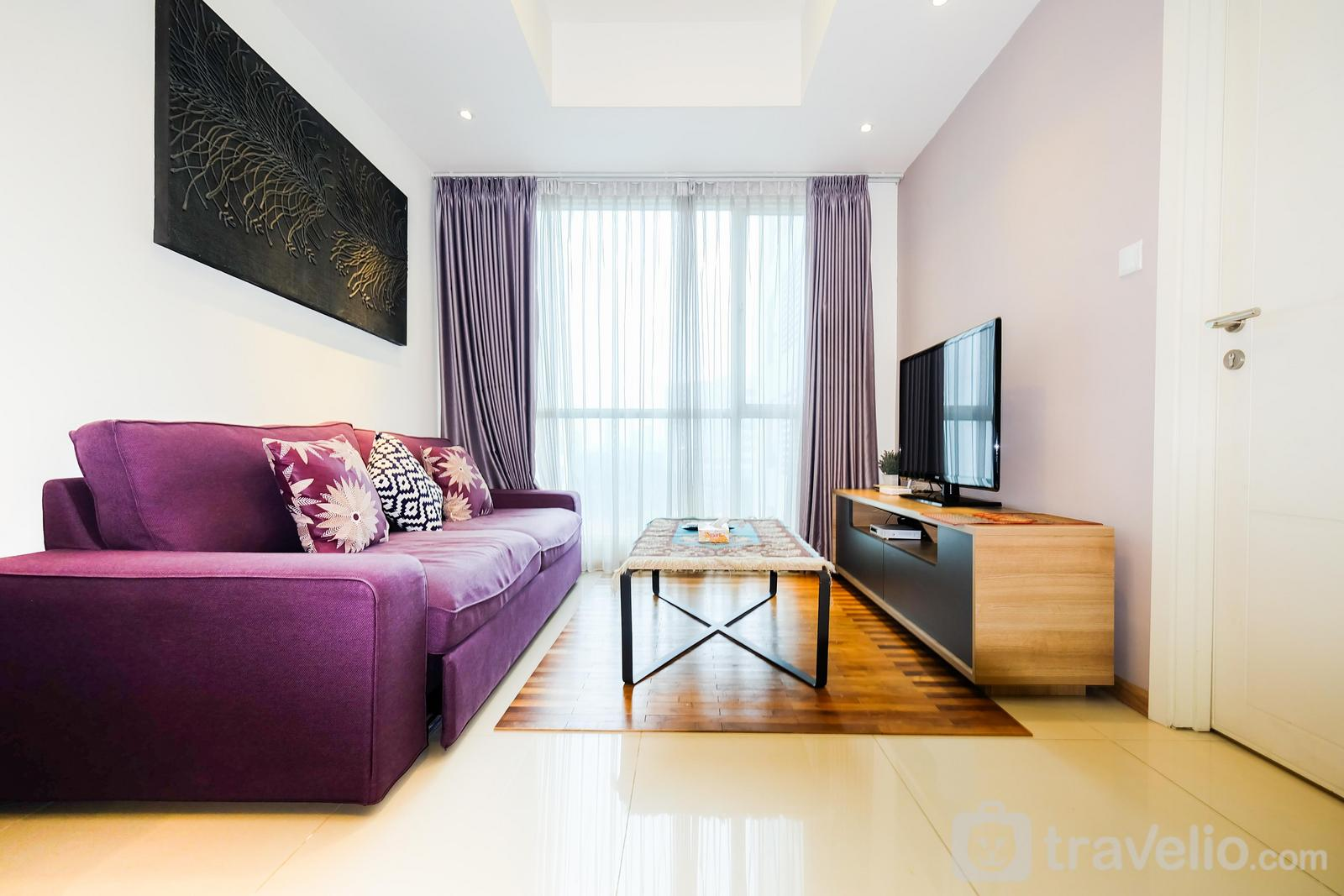 Casa Grande Residence - 1BR Apartment with Big Sofa Bed at Casa Grande Residence By Travelio