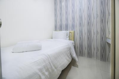 2 BR Apartment Green Pramuka City By Travelio